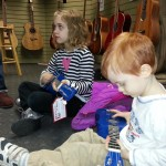 Learning about instrument types at the music store